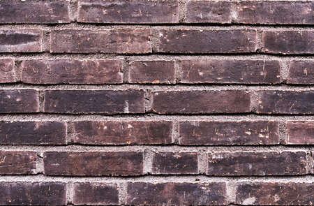 old brick wall: Weathered old building exterior brick wall background Stock Photo