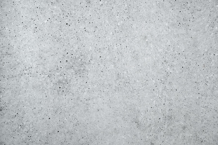 Light gray concrete wall surface background, close up of urban pattern texture Banco de Imagens