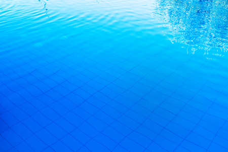 Blue outdoor poolside water surface as abstract background for summer holiday vacation themes