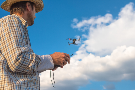 Farmer using drone remote control, smart farming agricultural activity and the future of agriculture