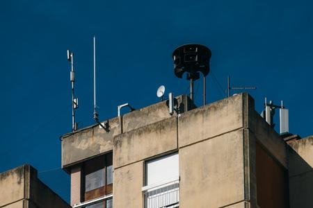 Civil Defense Siren On Top Of Apartment Building Also Known As Air Raid