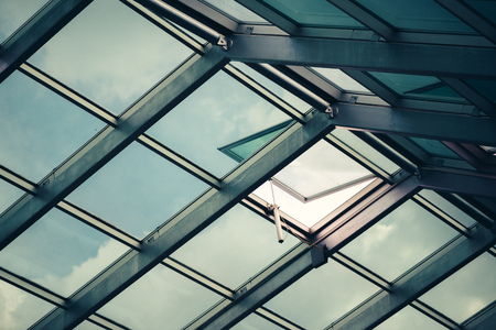 feature: Glass skylight roof with open window, architectural feature detail Stock Photo