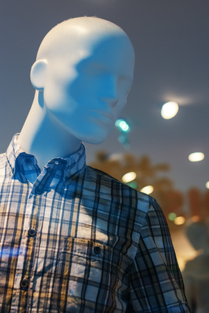 clothing store: Showroom boutique mannequin with clothes on sale, male figure portrait, selective focus Stock Photo