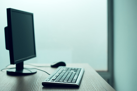 Desktop PC computer in empty office, closing small business and entrepreneurship background Stock Photo