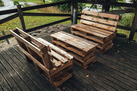DIY pallet outdoors furniture in house backyard, selective focus
