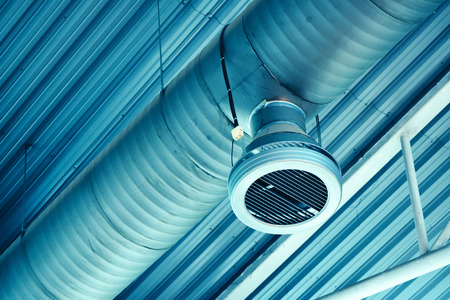 Industrial warehouse air ventilation system pipe on the ceiling
