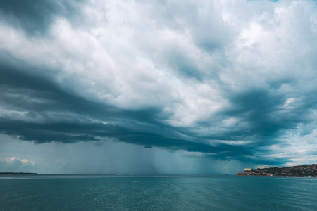 Stormy sky with clouds over Portoroz seascape. Bad weather is comming to Slovenian tourist resort on Adriatic sea coast. Stock Photo