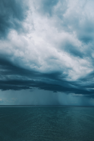 Stormy clouds over seascape, rainy season weather and climate Banco de Imagens