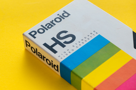 NOVI SAD, SERBIA - NOVEMBER 6, 2017: Polaroid video cassette. Video Home System, recording tape cassettes was released in Japan in late 1970s. Retro video technology illustrative editorial.
