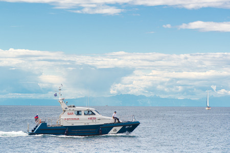PIRAN, SLOVENIA - SEPTEMBER 3, 2017: Slovenian police coast guard boat at open sea. Border disputes between Slovenia and Croatia revolves around boundary in the Gulf of Piran. Both nations have agreed to international arbitration.