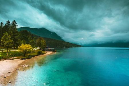Raining on Bohinj lake beautiful Bohinj lake. Unique glacial lake in Slovenian national park Triglav.