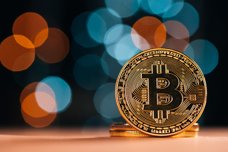 Bitcoin BTC cryptocurrency. BTC golden coin as symbol of electronic virtual money for web banking and international network payment 写真素材