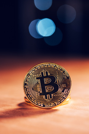 Bitcoin BTC cryptocurrency. BTC golden coin as symbol of electronic virtual money for web banking and international network payment Stock Photo