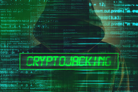 Cryptojacking concept, computer hacker with hoodie and lines of script code overlaying image Stock Photo