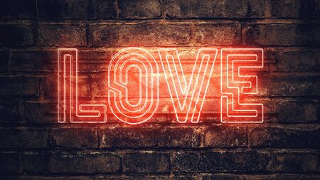 Love neon sign mounted on brick wall