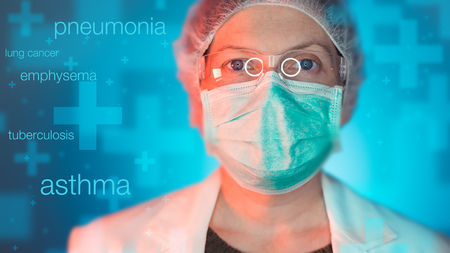 Pulmonologist healthcare professional in hospital clinic. Portrait of female medical specialist treating lung diseases such as asthma, bronchitis, pneumonia, tuberculosis, emphysema and chest infections. Stock Photo