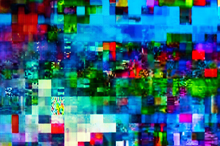 Digital TV glitch on television screen with misplaced squares, static effects and freezing problems during broadcast failure