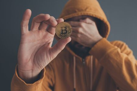 Man offering bitcoin, conceptual image for payment with cryptocurrency Stock Photo