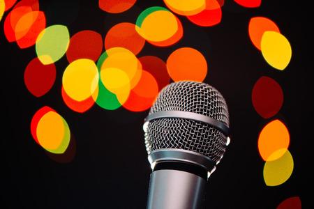 Audio microphone in karaoke bar with festive bokeh light background Archivio Fotografico