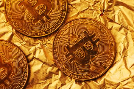 Bitcoin, blockchain cryptocurrency golden coin on gold metal background to emphasize the value of virtual currency in modern world Stok Fotoğraf