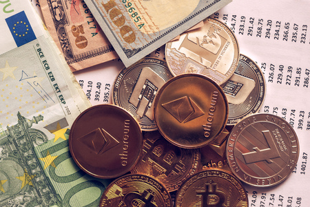 Cryptocurrency coins with exchange rate table, various crypto money with traditional USA and Euro currency banknotes on business office desk