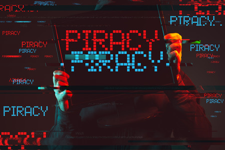 Internet piracy concept with faceless hooded male person, low key red and blue lit image and digital glitch effect 版權商用圖片