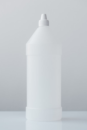 White plastic bottle container for medical ethyl alcohol with blank surface as copy space