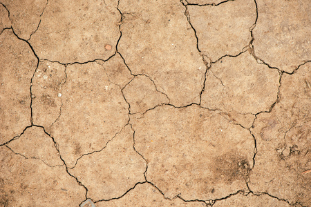 Top view of cracked dry soil ground texture for drought season background 스톡 콘텐츠