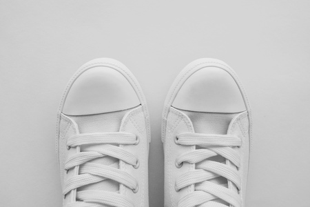 Pair of white sneakers with copy space, modern casual canvas shoes