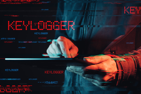 Keylogger concept with male person using tablet computer, low key red and blue lit image and digital glitch effect