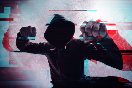 Violence and crime on the streets, digital glitch effect, victim is punched and mugged by aggressive violent man in hooded jacket, cctv security camera pov perspective Stock Photo