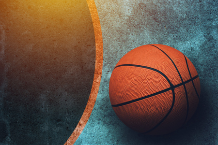 Streetball concept with basketball ball and copy space on dark concrete surface, top view Stock Photo