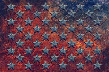 Embossed USA flag star shapes on rusty metal surface, worn metallic texture as background