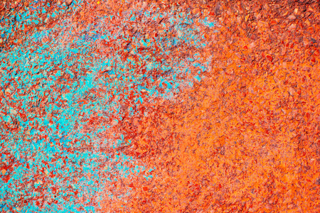 Grunge teal and orange background. Concrete surface painted with saturated colors. Stock Photo