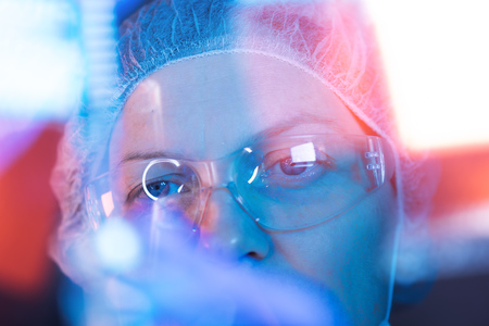 Pharmacology science researcher working in laboratory on development of new immunology vaccine Stock Photo