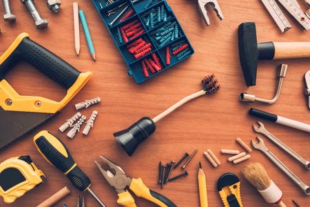 DIY housework maintenance and repair project tools on workshop desk, top view