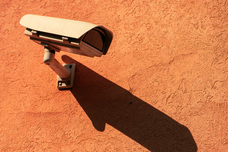 Surveillance camera on exterior wall with blank copy space