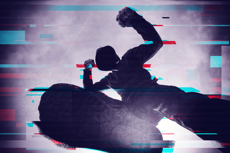 Violence and crime on the streets, digital glitch effect, victim is punched and mugged by aggressive violent man in hooded jacket, pov perspective Stock Photo
