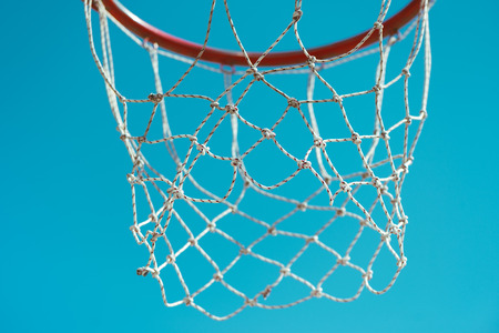 Basketball hoop with net, abstract minimalistic image with selective focus