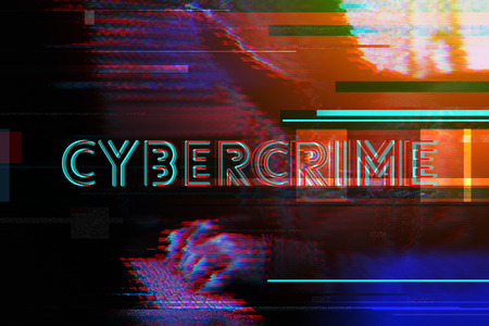 Cybercrime concept with hooded hacker typing computer keyboard, modern futuristic digital glitch effect