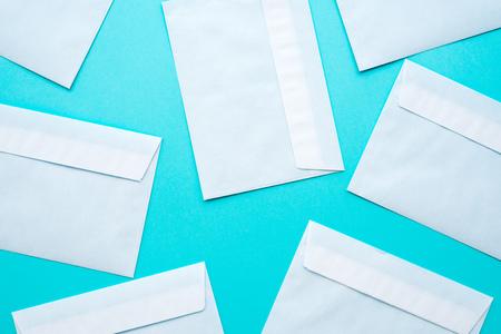 White mail envelopes mock up on blue background Reklamní fotografie