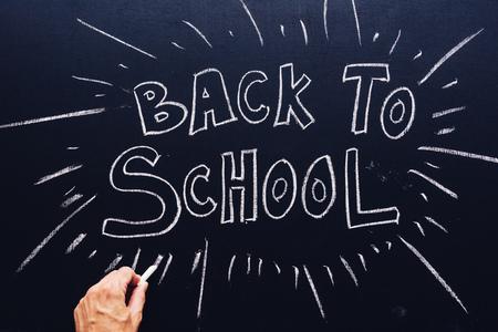 Back to School written on classroom chalkboard, new semester is starting
