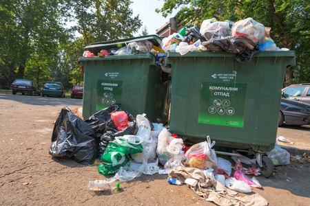 NOVI SAD, SERBIA - AUGUST 18, 2018: Municipal solid waste or communal garbage is overflowing containers in Novi Sad during weekends, illustrative editorial