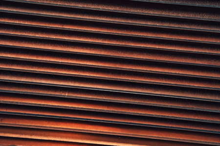 Rusty metal shutters as background and urban industrial texture