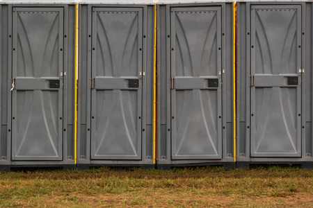 Portable public toilet booths in a row