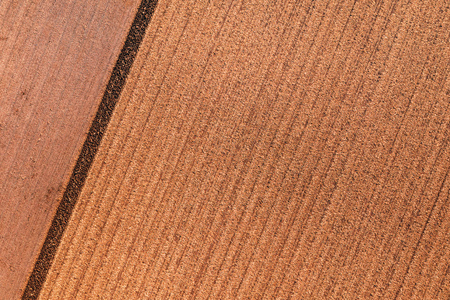 Aerial view of field stubble from drone pov on bright sunny autumn day
