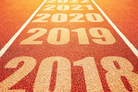 2019 New Year concept, number sequence on athletic sport all weather running track in perspective