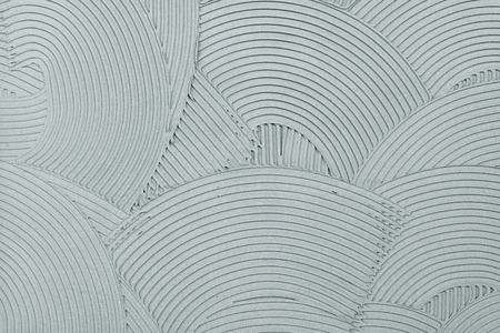 Decorative plaster wall finish texture, modern urban wavy overlapping concentric circle pattern background
