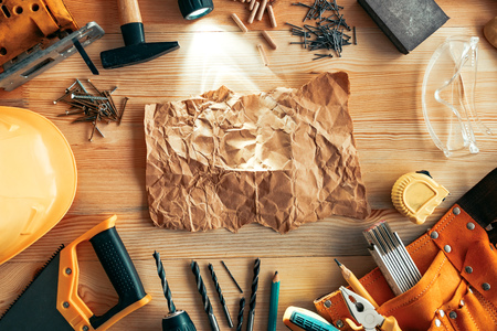Crumpled paper mock up on carpentry woodwork desk, top view Stock Photo