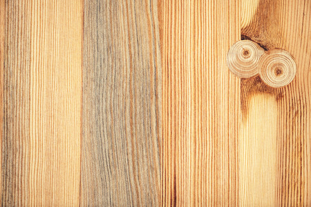 Texture of nice pine wood floorboard plank with knots repaired with wooden plugs